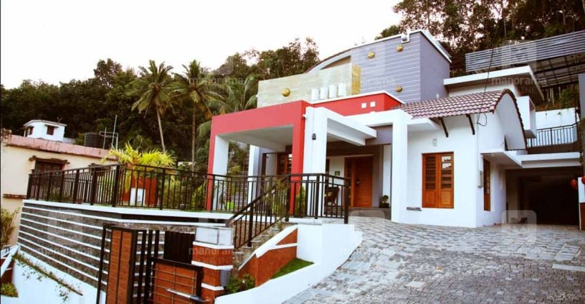Multi Level House On A Sl*P* In Konni That Is A Design Marvel   Home Front Stairs Design   Porch Attached Horizontal Staircase Tower   Parapet Wall   Sitout Step   Front Window   Interior