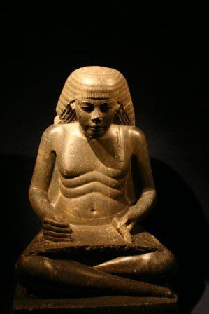 This Egyptian scribe show clearly an African character, his face can say a lot about it