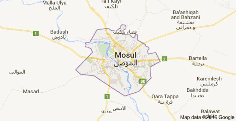 Des habitants de Mossoul se rangent sous les drapeaux de Daech