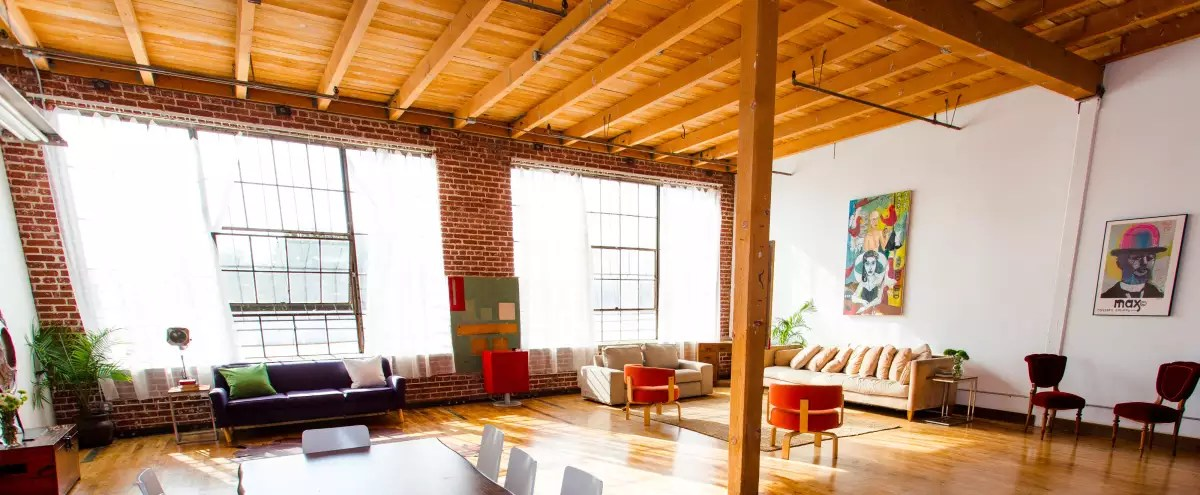 new york loft style living room furnishing a narrow natural light exposed brick free parking in los angeles