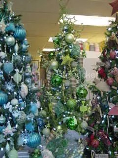 this one is a small 5 alpine tree tucked in between the primitive christmas tree and the turquoise tree i usually put the shorter trees up on something - Designer Christmas Trees