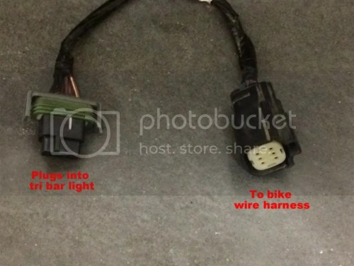 small resolution of the connector on the left plugs into the tri bar light and the other goes to the bike harness