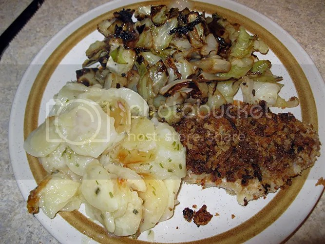 Crunchy pork/chicken, cabbage, and sout cream and chives potatoes