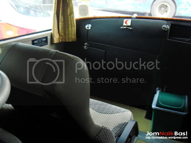 The unique seats beside the driver. Note also that these are the only seats on the bus with seatbelts.