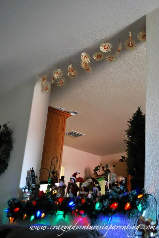 Christmas tree ornaments hanging from ceiling for Cheap christmas decoration ideas