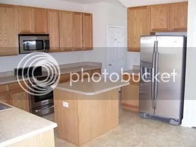 So sick of builders grade oak grain cabinets floor