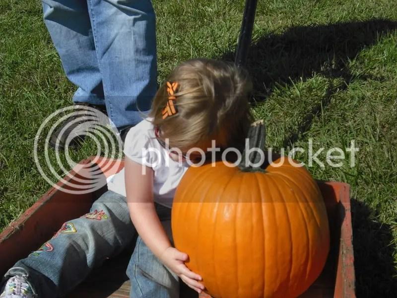 Giving her pumpkin a hug!