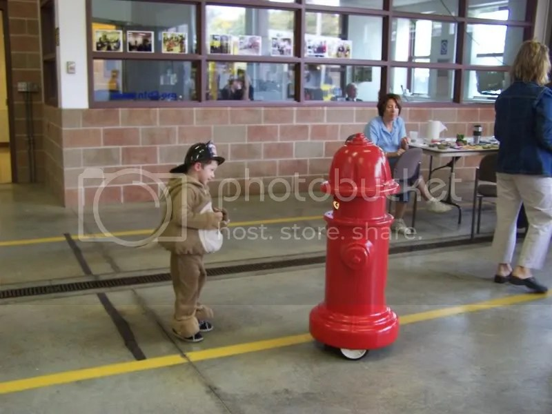 showing his costume off to the talking hydrant