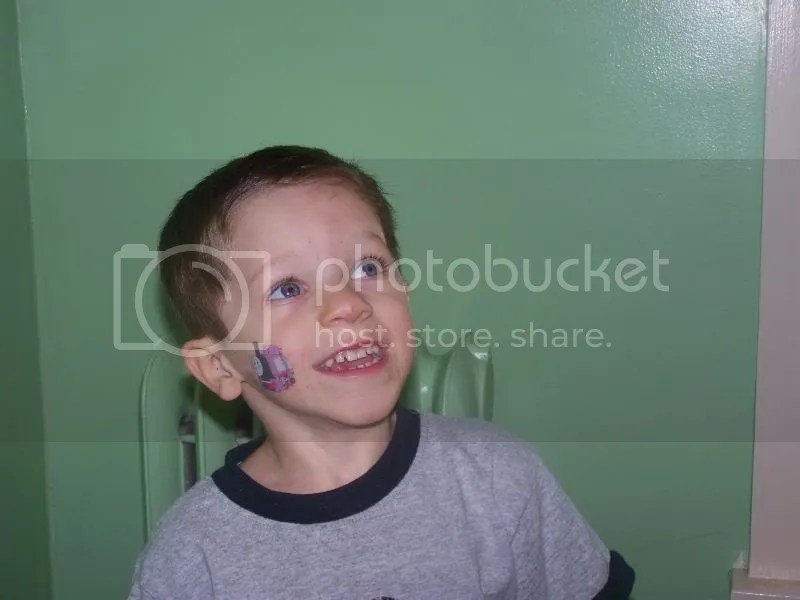 I\'ve never seen a child this amused by green paint...