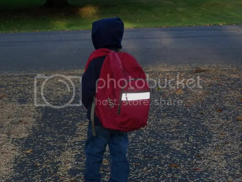The annual backpack waiting for the bus shot