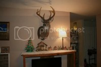 Living Room With Deer Mounts - [peenmedia.com]