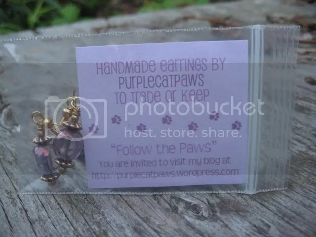 Purplecatpaws signature earring geoswag