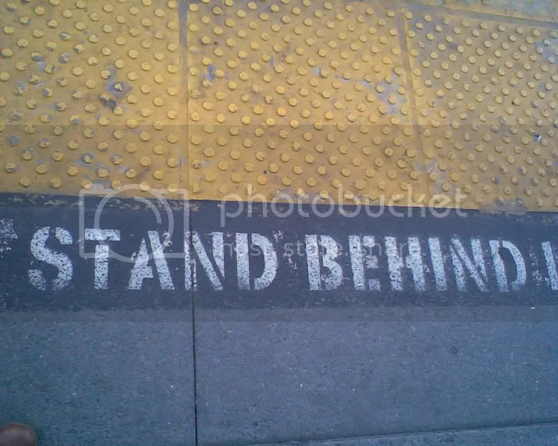 stand behind