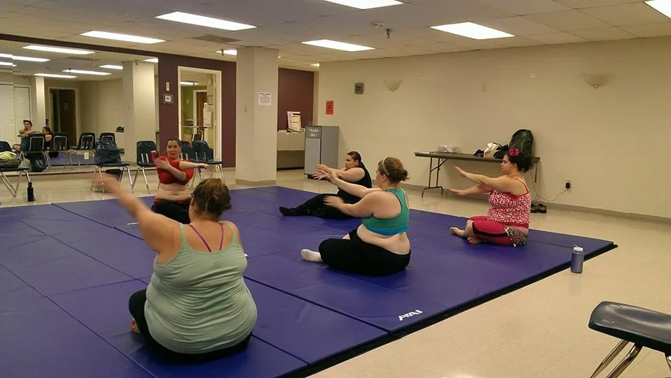 group of women doing bellydance stretches
