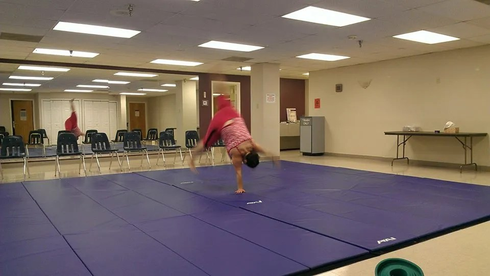 doing cartwheels on blue mats