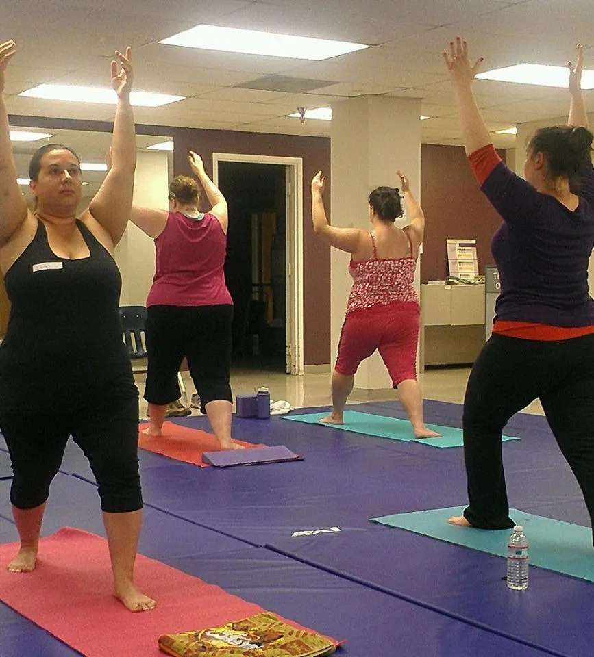group of women doing yoga