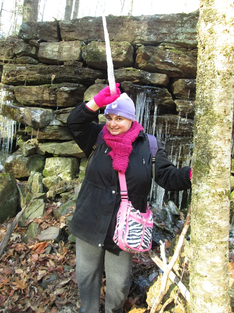 me holding an icicle up to my head like a unicorn horn