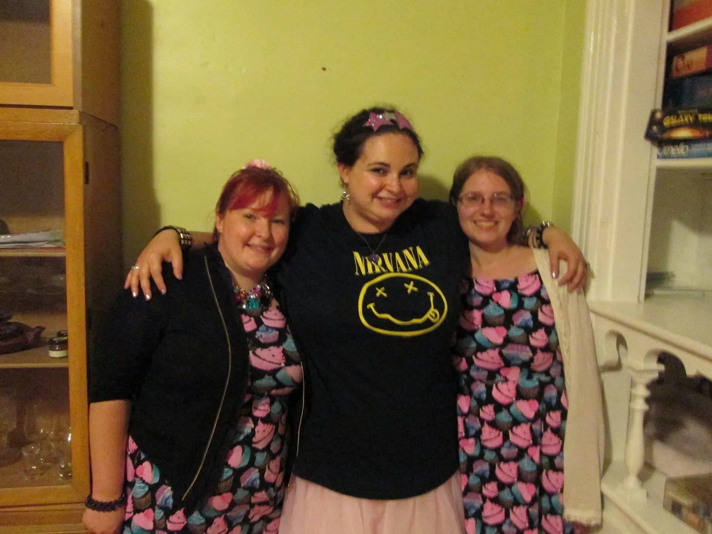 me wearing nirvana shirt and tutu with two friends wearing matching cupcake print dresses