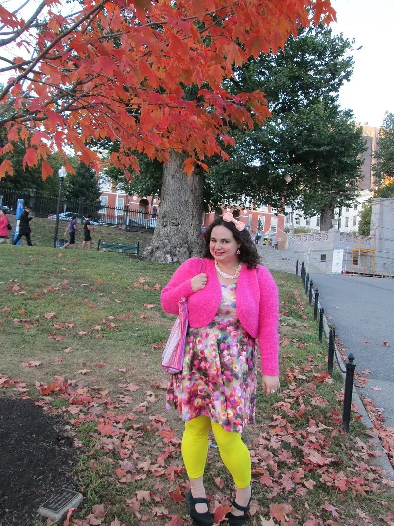 plus size outfit watercolor floral dress, yellow leggings, and pink fuzzy bolero