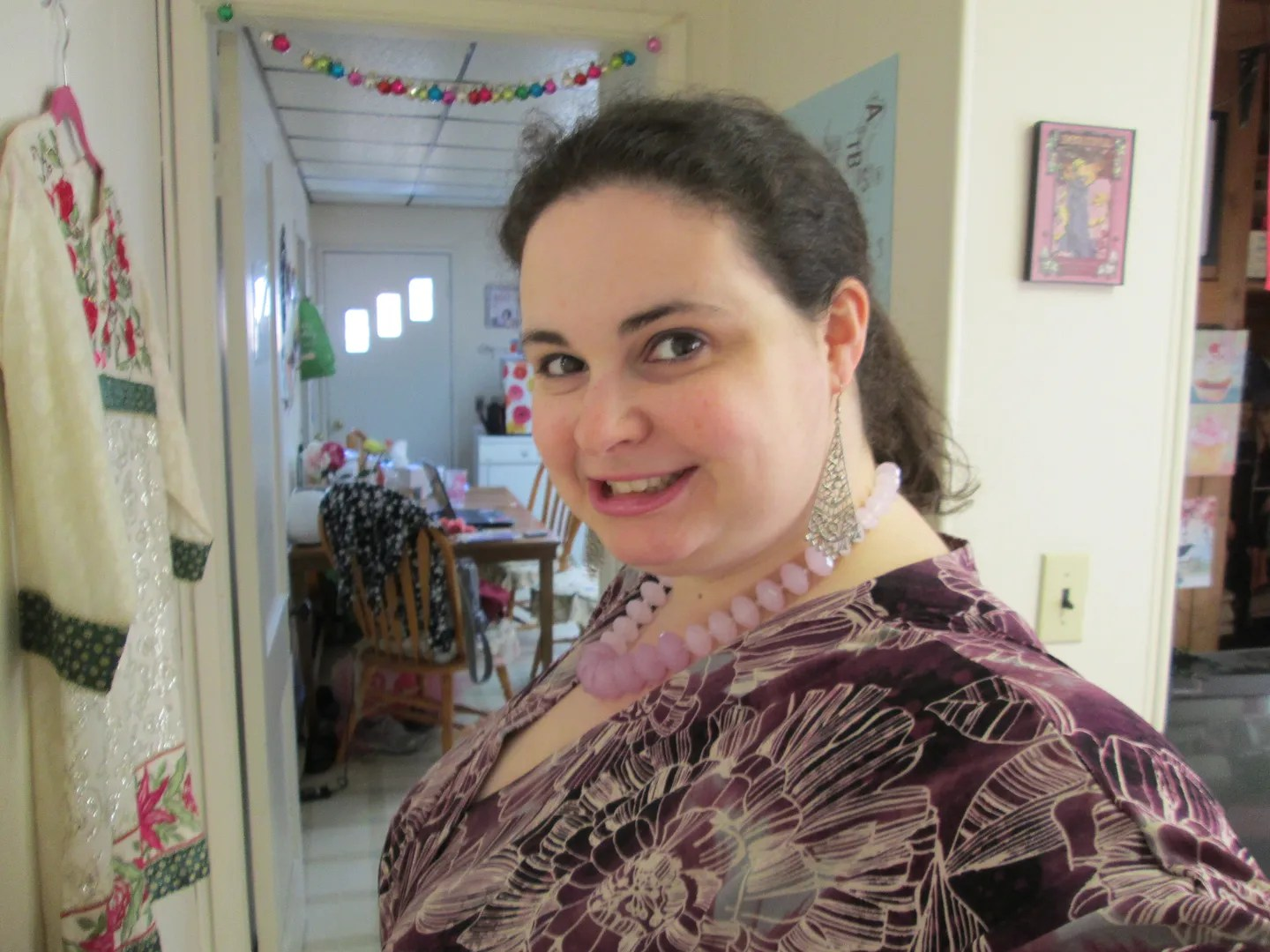 plus size outfit with purple and gray floral kimono top and black pants