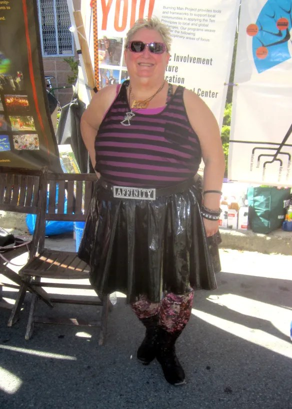 plus size goth outfit with purple striped top and wet look pleather skirt