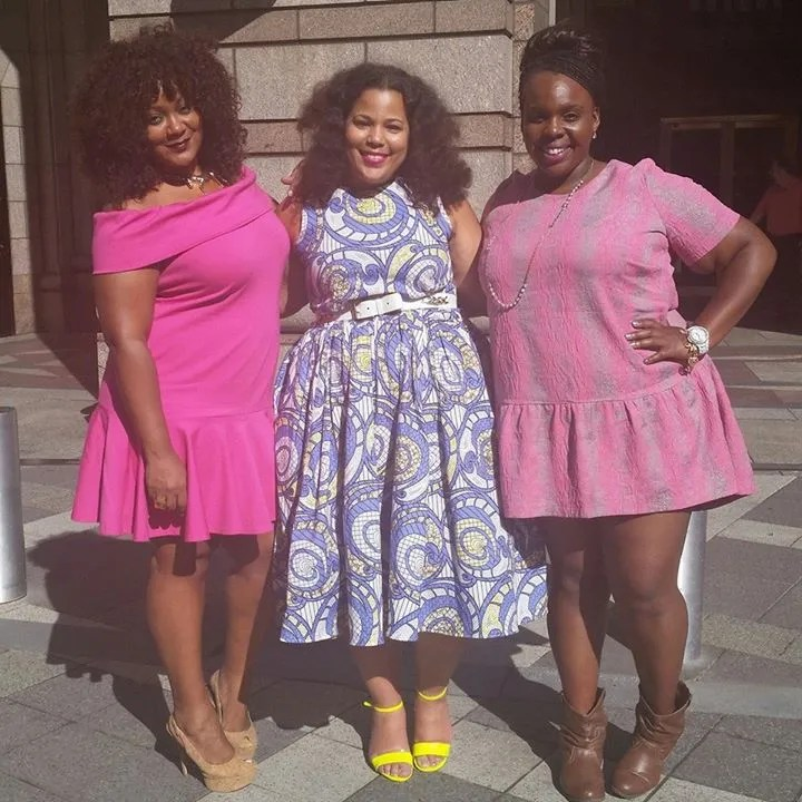 three women wearing pink and blue dresses at new york plus size fashion week