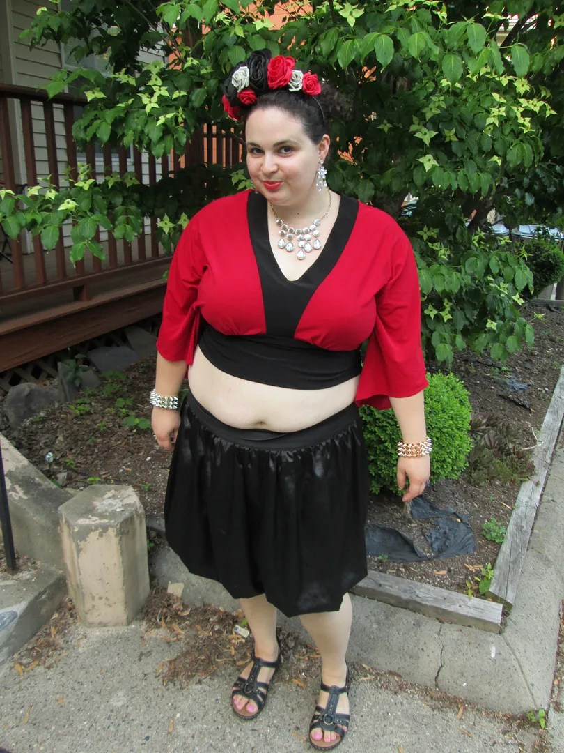 red and black crop top plus size outfit with floral crown