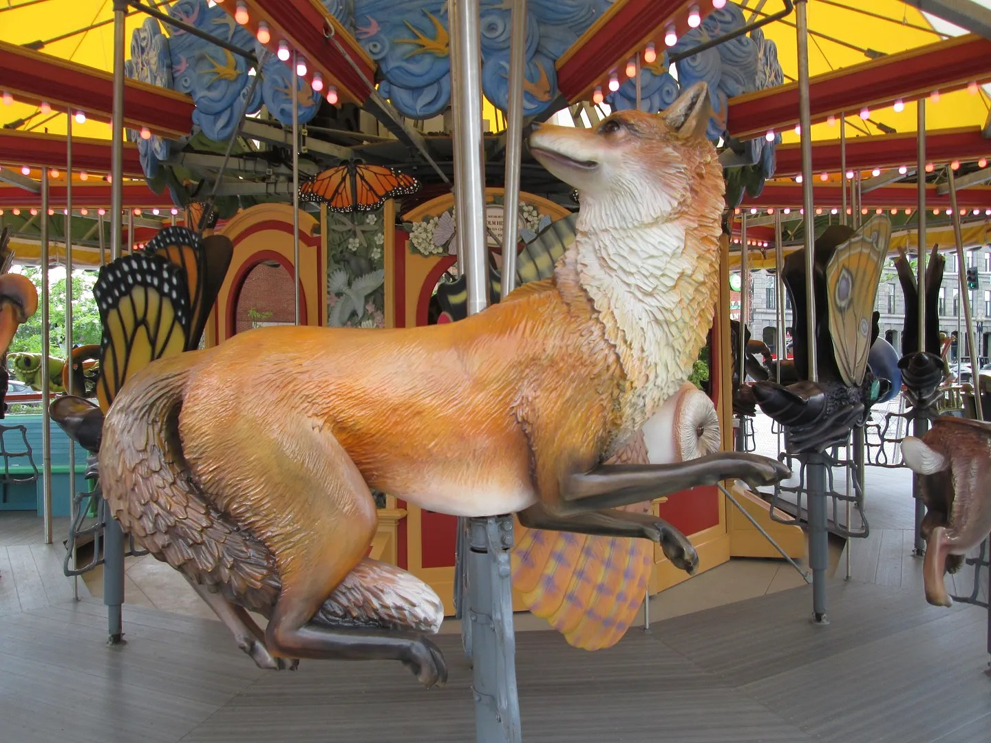 carousel with fox and butterflies