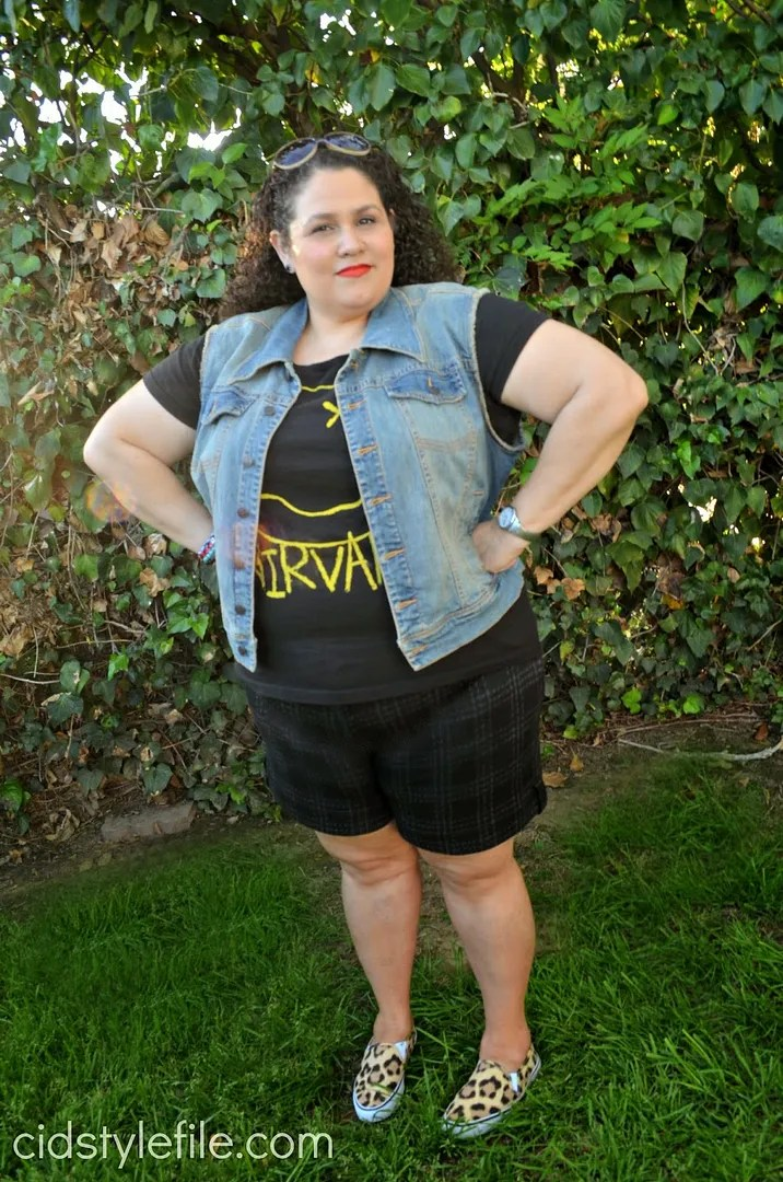 plus size outfit with nirvana shirt and black plaid shorts