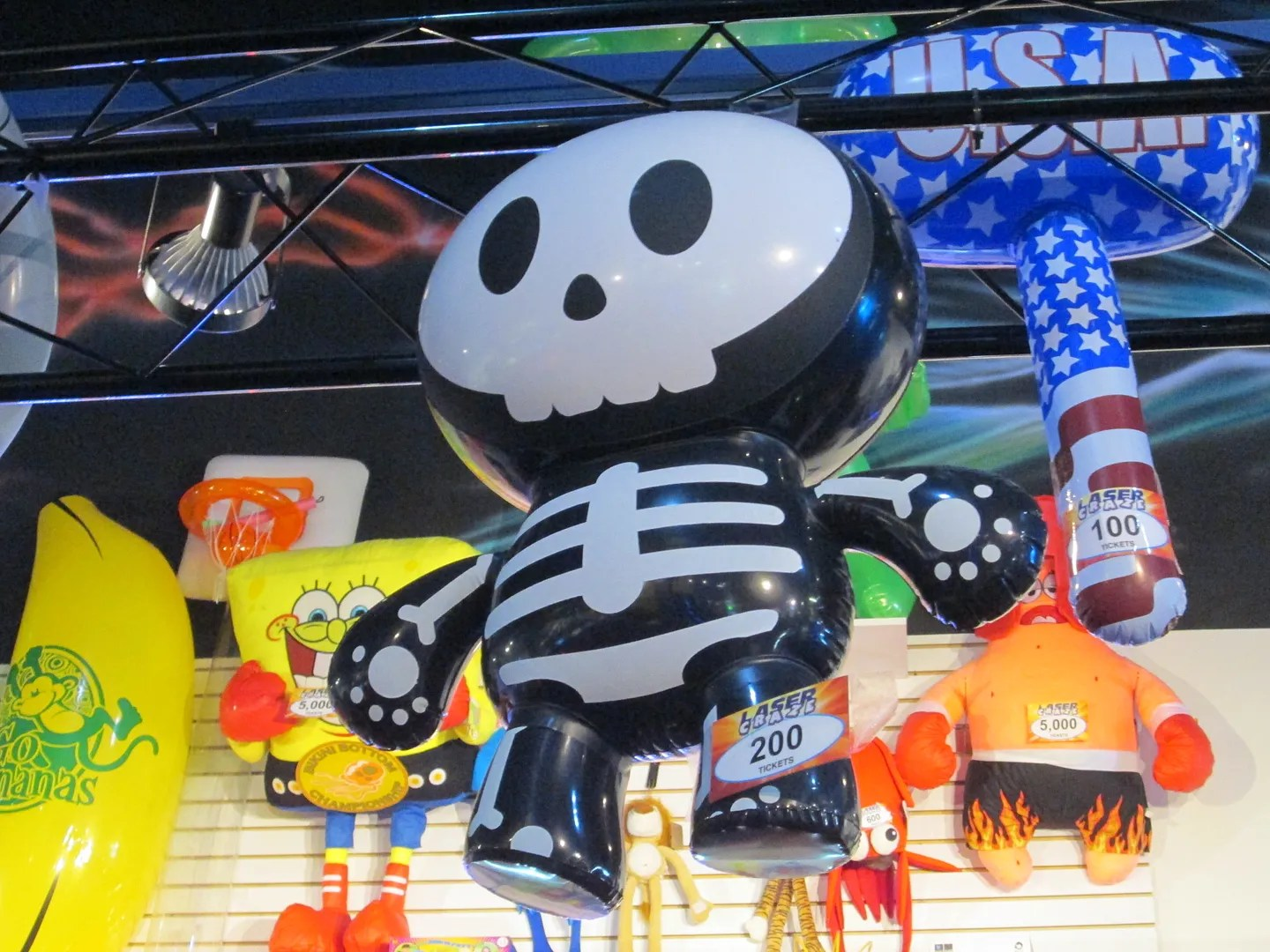 cute inflatable skeleton hanging up at an arcade