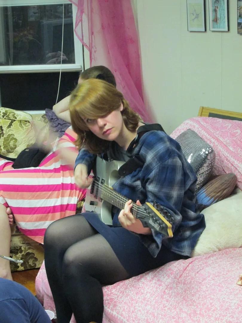 autumn wearing plaid shirt playing guitar