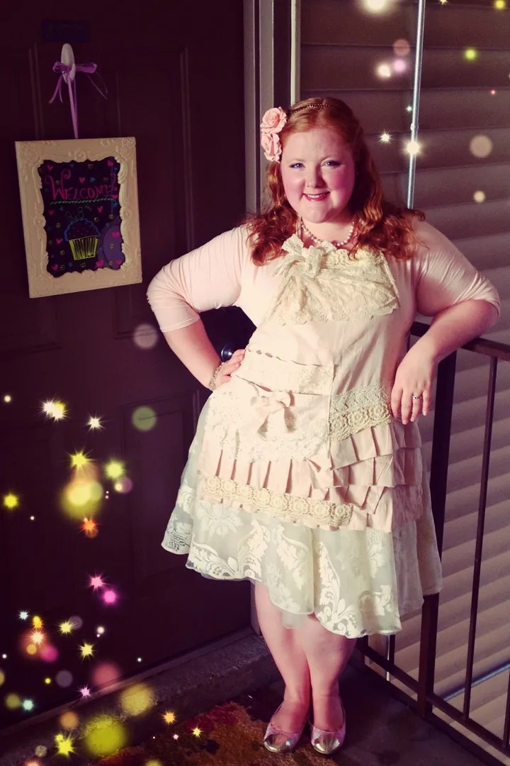 plus size feminine cupcake out with pink bolero, white tulle skirt, ruffle apron, and pink roses