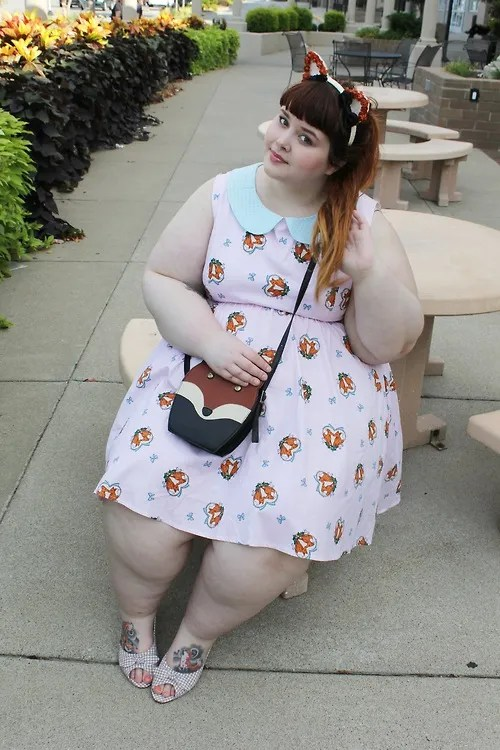 adorable plus size outfit with pink fox print dress, fox ears, and fox purse