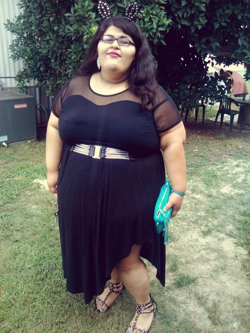 plus size outfit with black and sheer dress and studded bunny ears