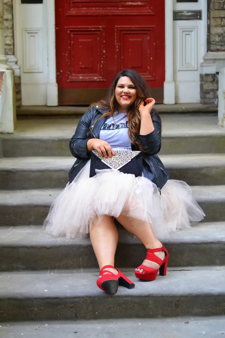 plus size outfit white tutu, gray t-shirt, leather jacket, and red platform sandals
