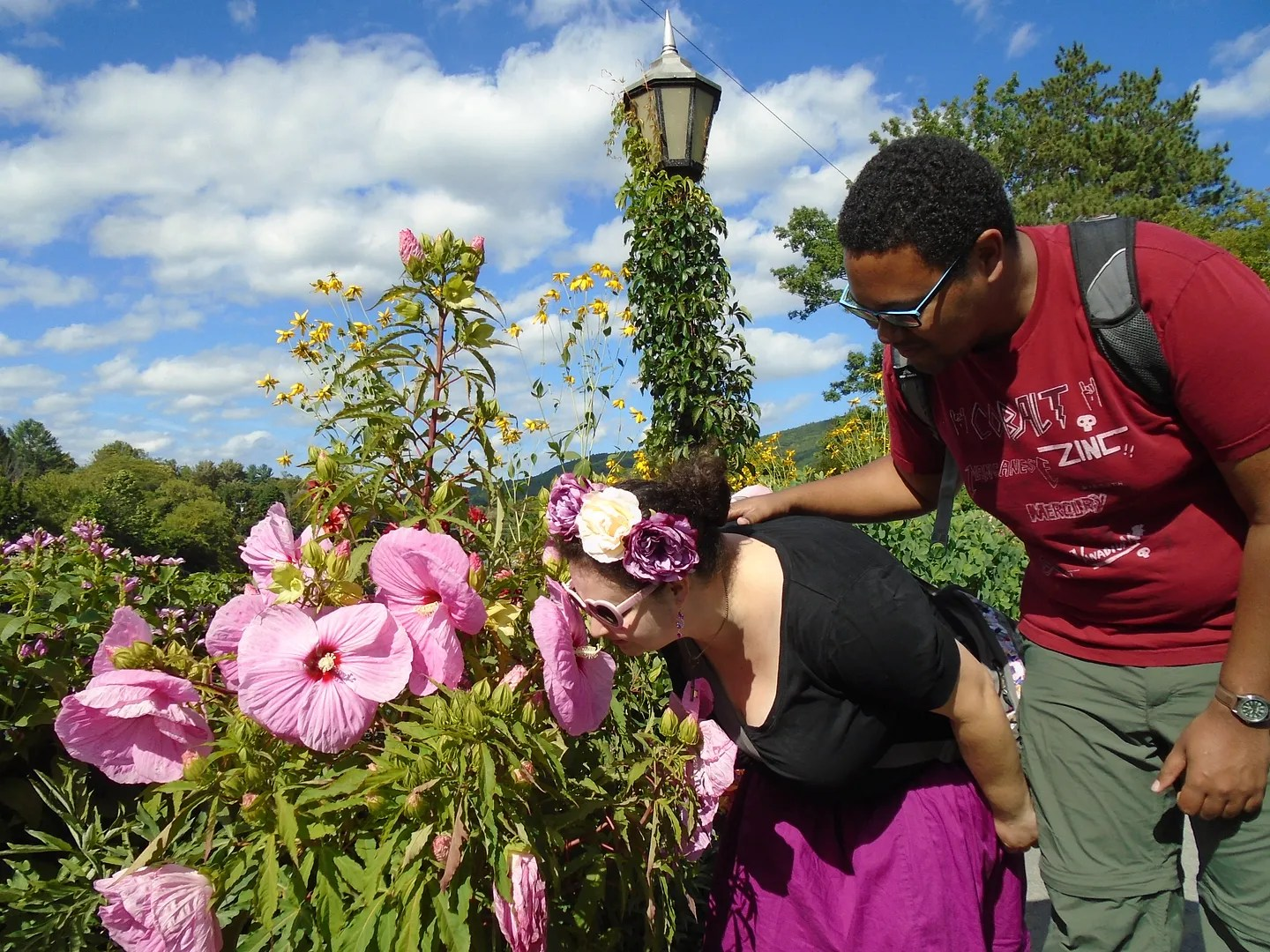 me and steve smelling pink hibiscus flowers on the bridge of flowers in shelburne falls