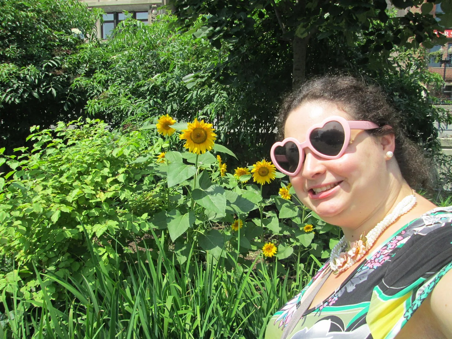 sunflower selfie with pink heart-shaped sunglasses