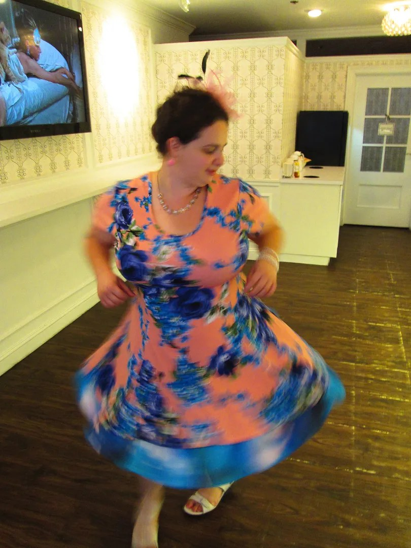 twirling in a pink floral plus size dress