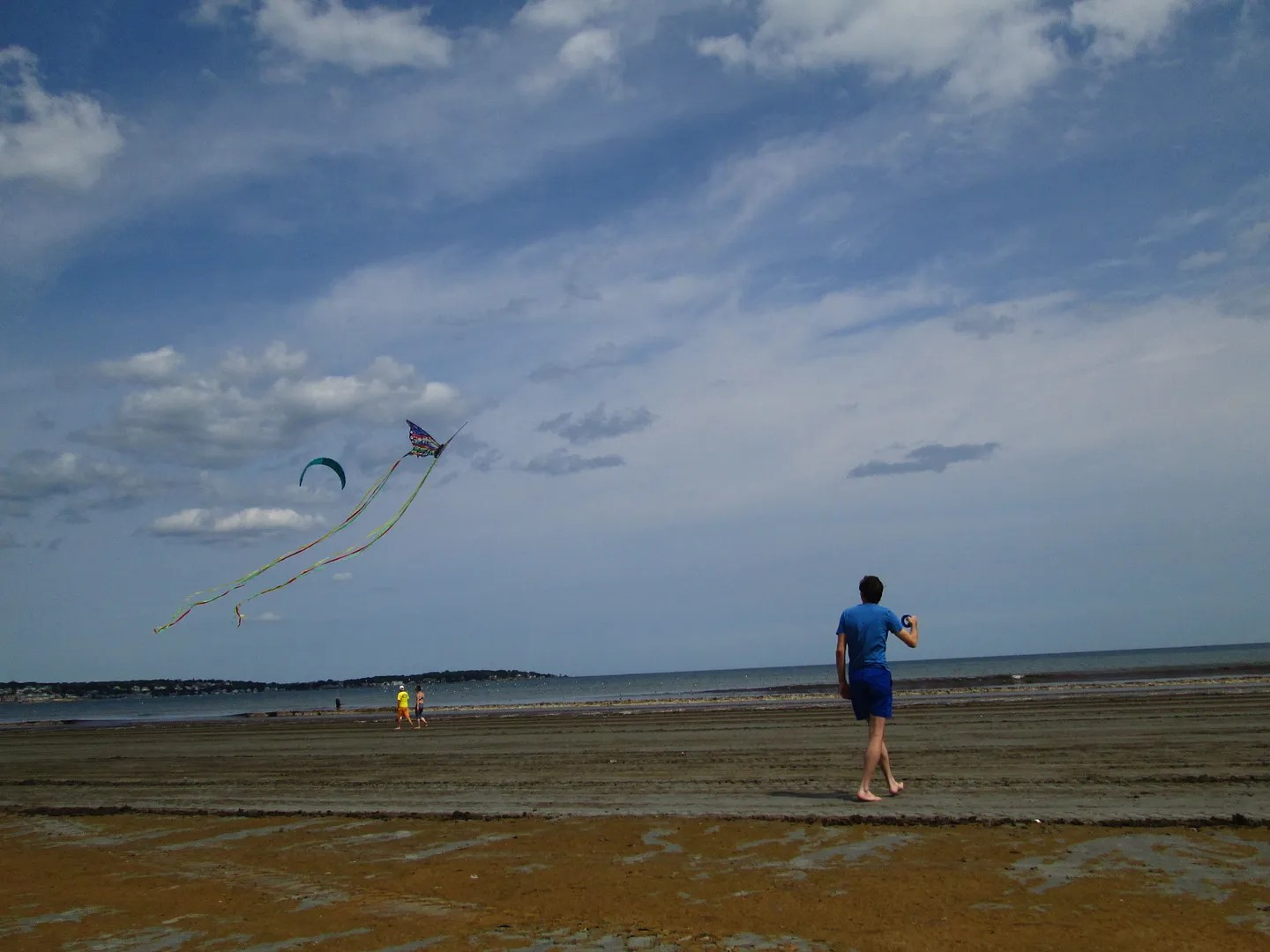 friend flying a kite on the beach