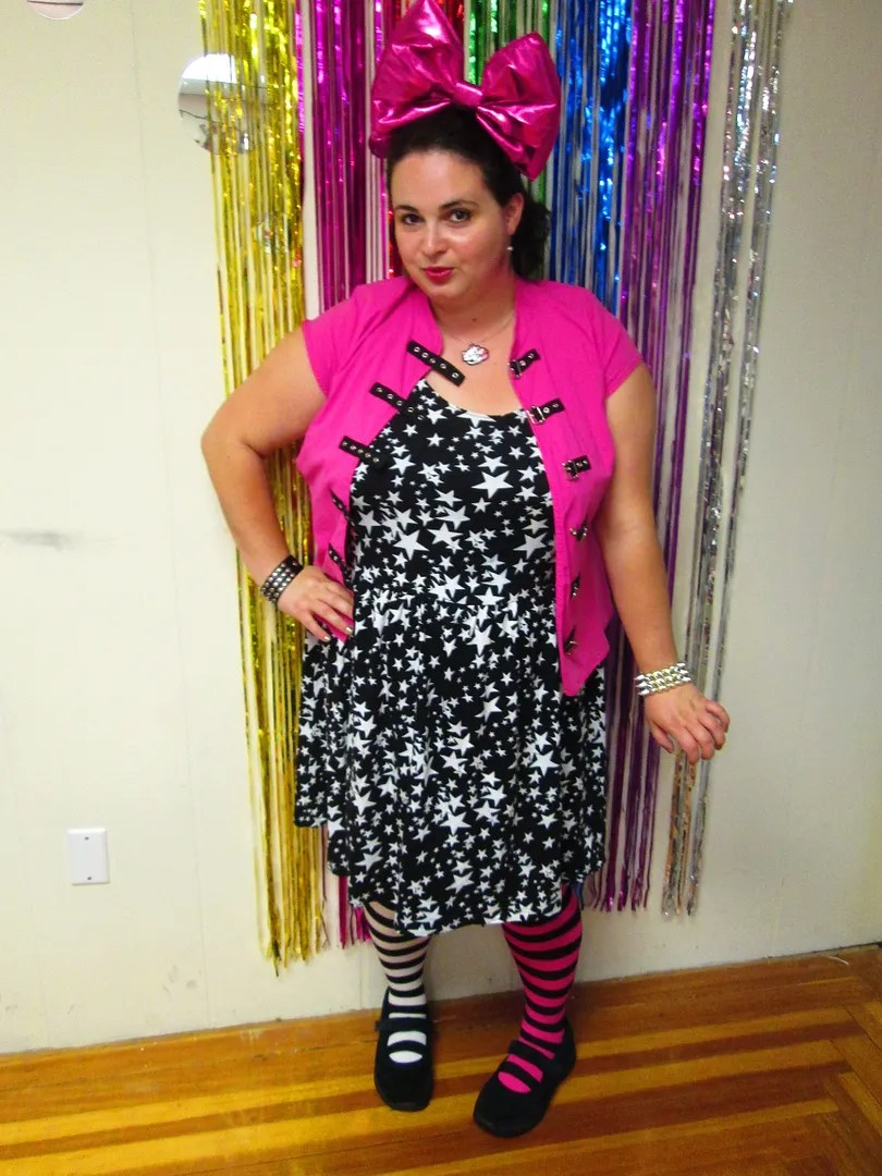 plus size star skater dress, pink shirt with buckles, and mismatched striped knee socks