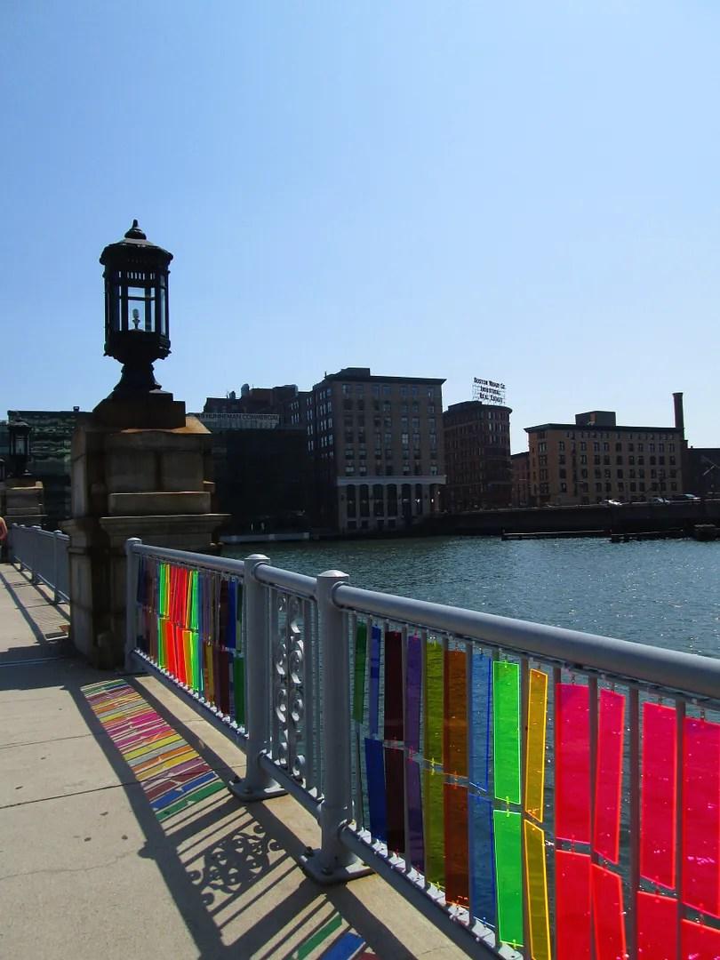 plexiglass rainbow panels attached to bridge in boston