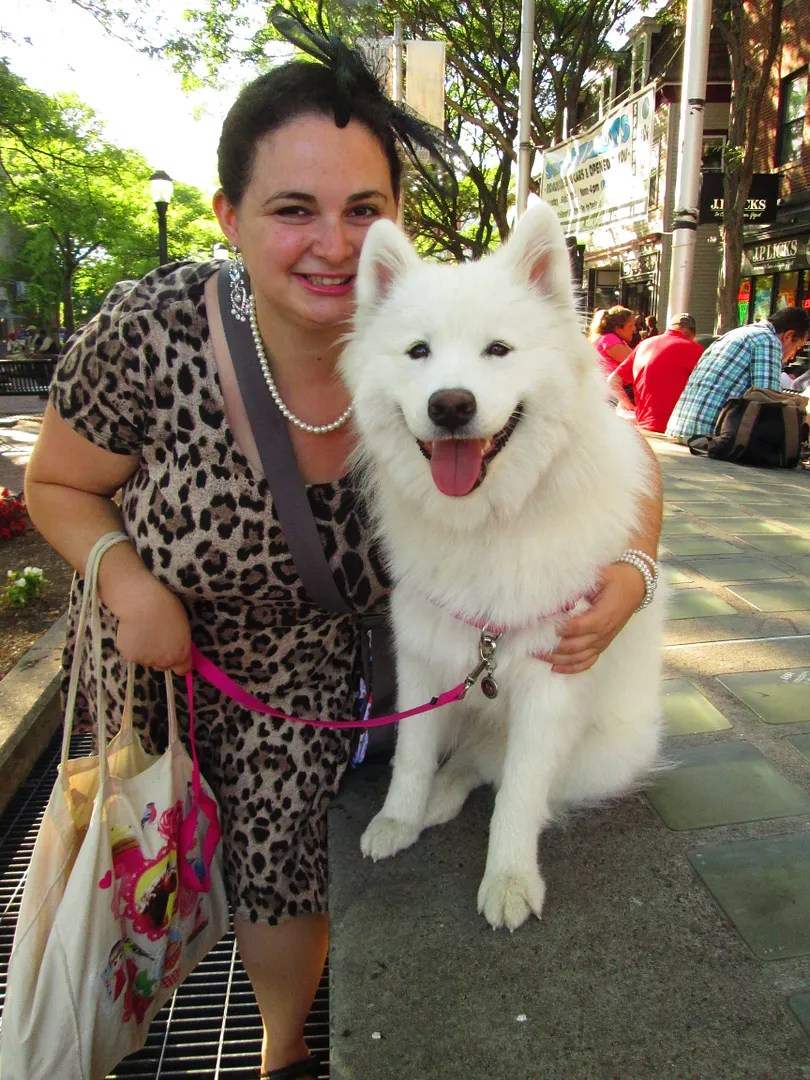 woman in leopard dress with samoyed dog