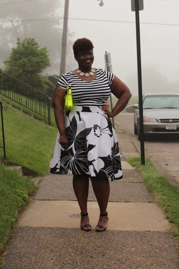 plus size black and white stripes and floral outfit with neon yellow clutch