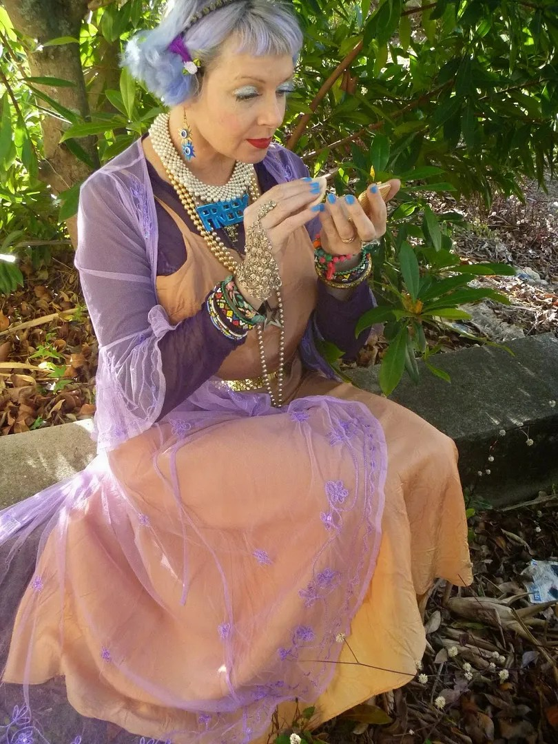 vintage outfit with lavender sheer jacket, beige slip dress, lots of accessories, lilac pastel hair