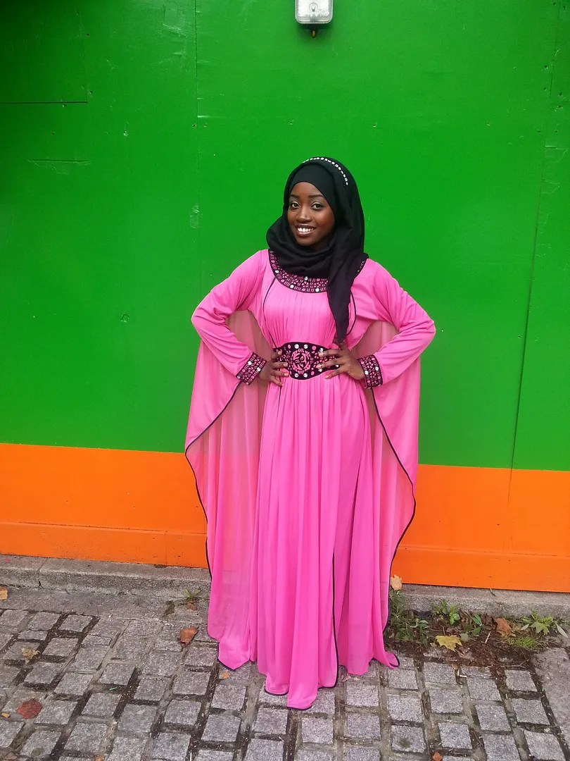 hijabi outfit hot pink dress with long sleeves and black headscarf