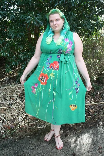 plus size outfit with green maxi dress with embroidered flowers and green hair