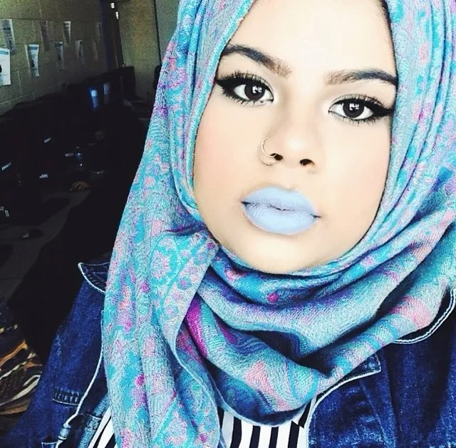 hijabi fashion look with blue and purple hijab, blue lipstick, denim jacket, striped top