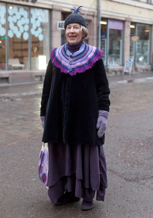 helsinki fashion woman wearing purple layered outfit with knitted collar