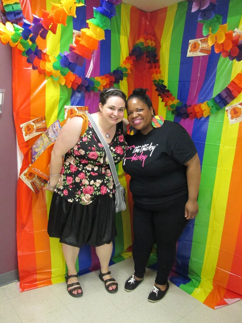 two women in rainbow photobooth
