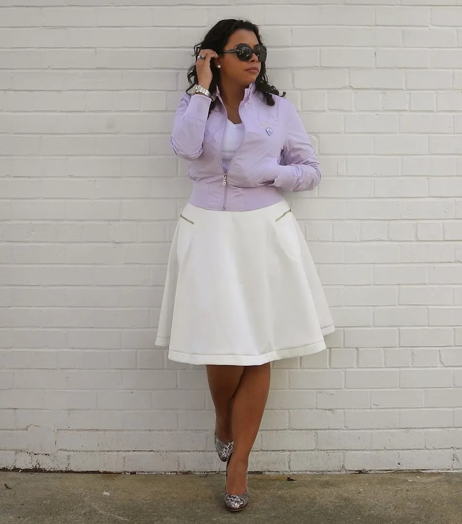 woman wearing white skirt and lavender leather jacket